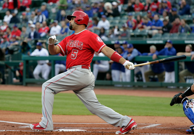Los Angeles Angels' Albert Pujols follows through on a foul ball to left in the first inning of a baseball game against the Texas Rangers in Arlington, Texas, Monday, April 9, 2018. (AP Photo/Tony Gutierrez)